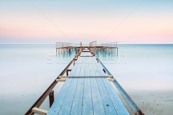 Long esposure view of a old jetty in a calm sea with gentle sky, Stock photo © Taiga