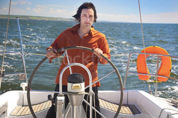 Young Man is Sailboat Captain Stock photo © Taiga