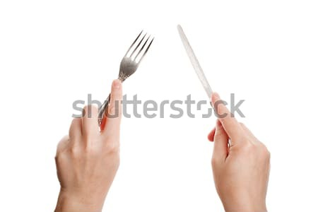 Knife and fork in hands Stock photo © Taigi