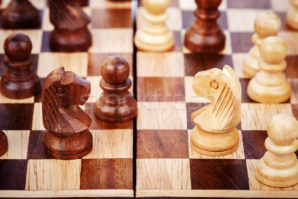 Fából készült sakkfigurák tábla sport ló háttér Stock fotó © Taigi