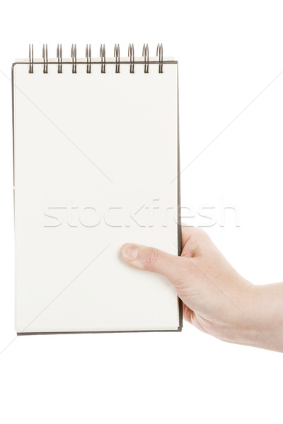 Stock photo: Hand holding spiral notebook