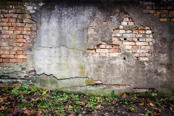 старые кирпичная стена выветрившийся стены кирпича землю Сток-фото © Taigi