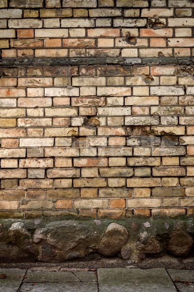 Amarillo pared de ladrillo piedra sótano edificio pared Foto stock © Taigi