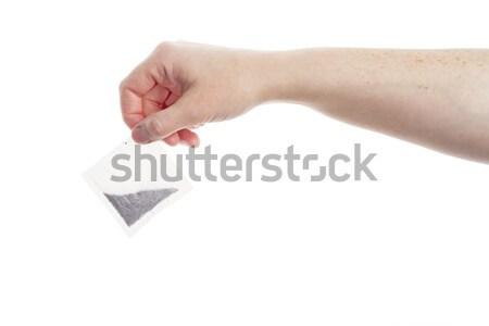 Female hand holding teabag Stock photo © Taigi
