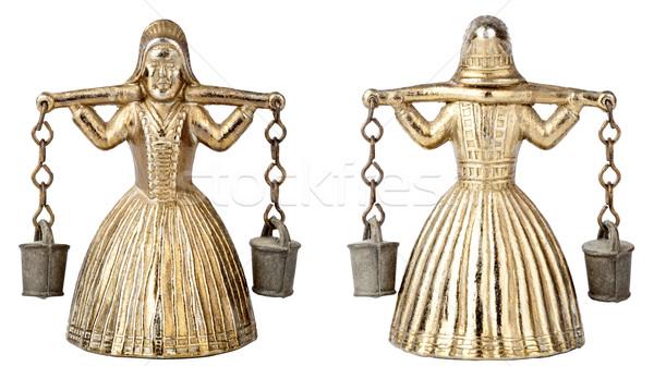 Vintage brass bell shape of a woman with a yoke Stock photo © Taigi
