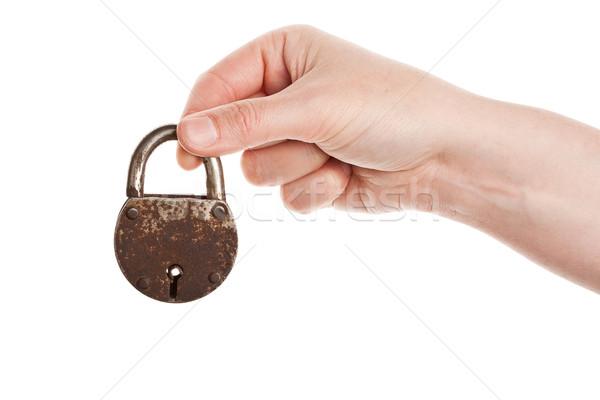 Stock photo: Hand holding old padlock