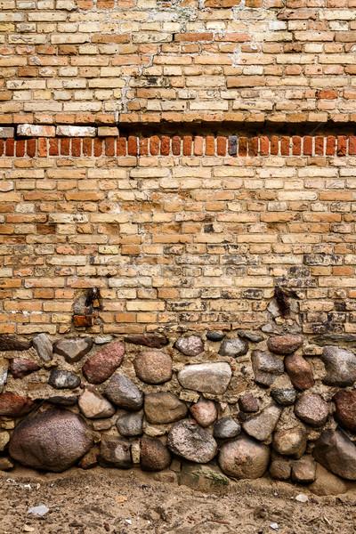 Giallo muro di mattoni pietra seminterrato casa texture Foto d'archivio © Taigi
