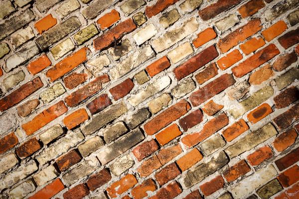 Amarelo vermelho parede de tijolos textura casa edifício Foto stock © Taigi