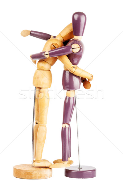 Two wooden dummies hugging each other Stock photo © Taigi