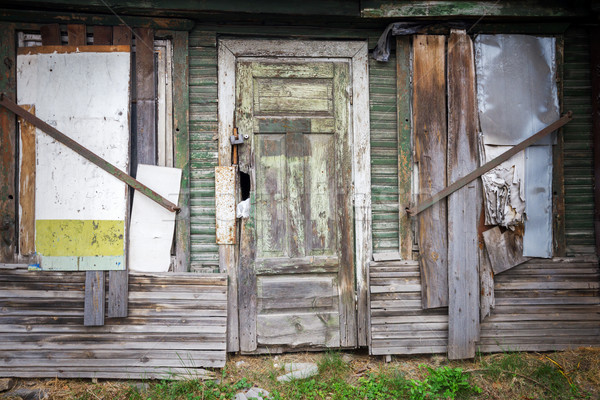Boarded up windows and old door Stock photo © Taigi