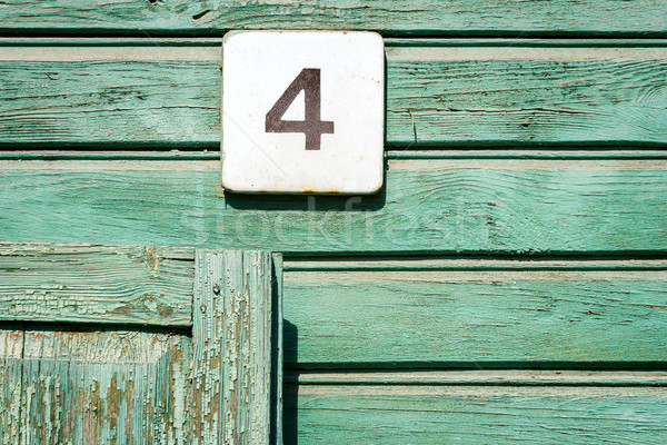 Number 4 on a wall Stock photo © Taigi