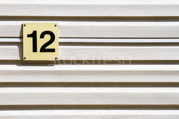 Aantal 12 muur plastic plank huis Stockfoto © Taigi