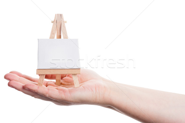 Hand holding easel with canvas Stock photo © Taigi