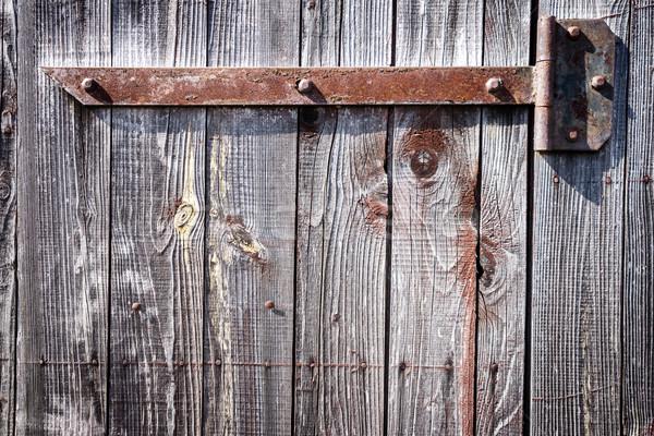 Ferro dobradiça porta enferrujado velho Foto stock © Taigi