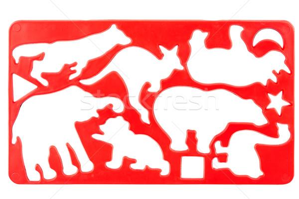 Oude plastic stencil Rood geïsoleerd witte Stockfoto © Taigi