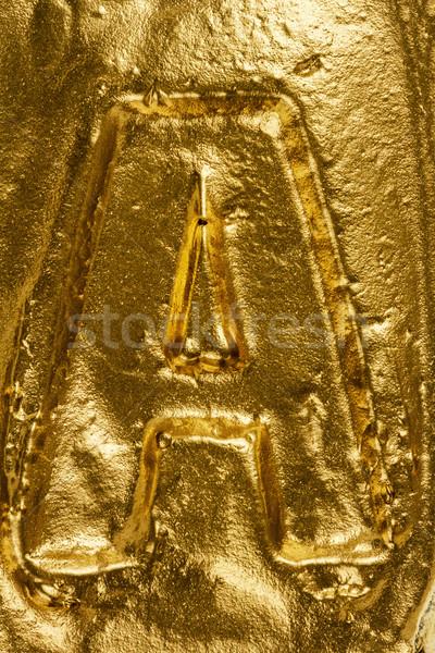 Lettera bella lucido tessitura oro Foto d'archivio © Taigi