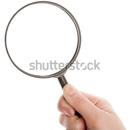 Stock photo: Hand holding magnifying glass