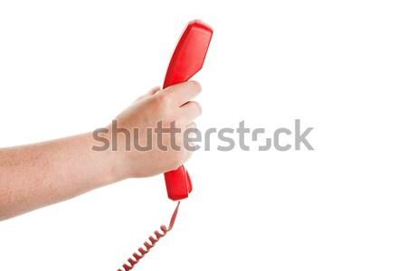 Piros telefonkagyló kéz izolált fehér üzlet Stock fotó © Taigi