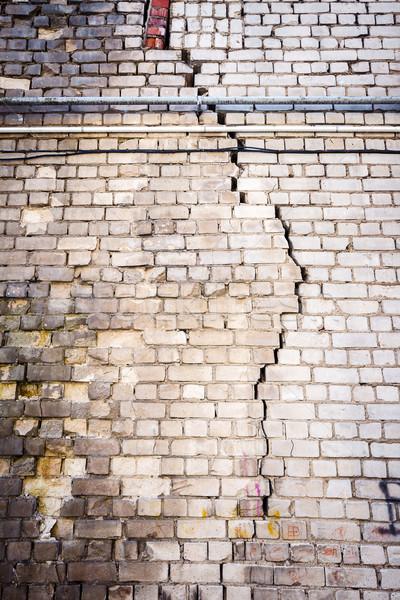 Edad agrietado blanco pared de ladrillo textura fondo Foto stock © Taigi