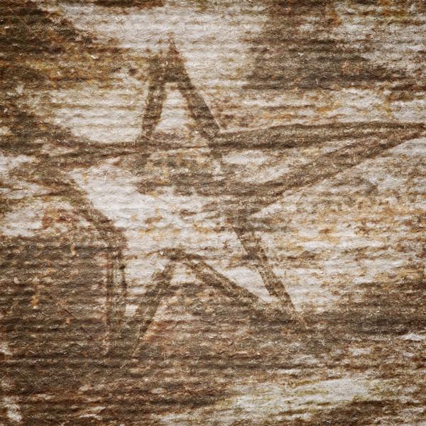 Grungy star on a handmade paper texture  Stock photo © Taigi