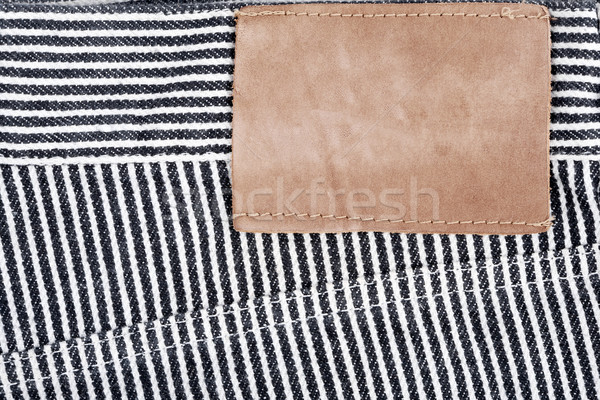 Blank leather jeans label sewed on a striped jeans  Stock photo © Taigi
