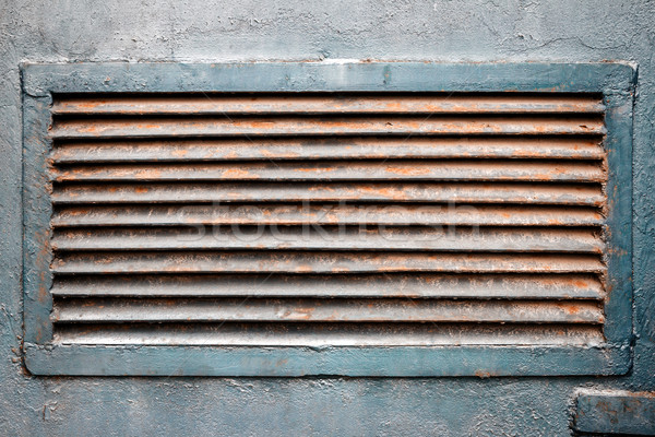 Rusty ventilation grille in metal wall Stock photo © Taigi
