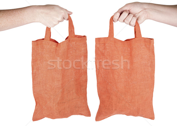 Hand holding orange fabric reusable shopping bag Stock photo © Taigi