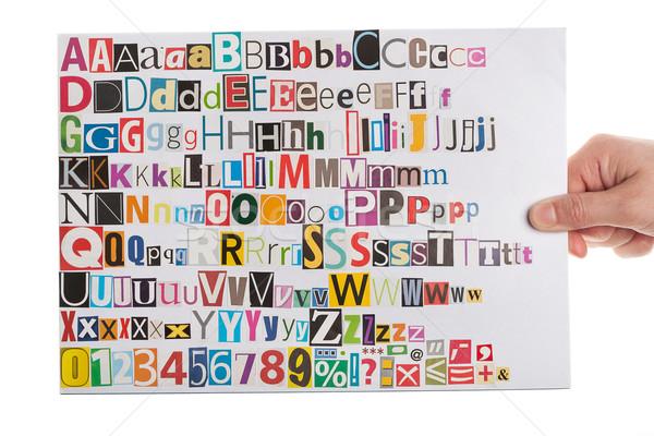 Stockfoto: Hand · krant · alfabet · brieven · nummers