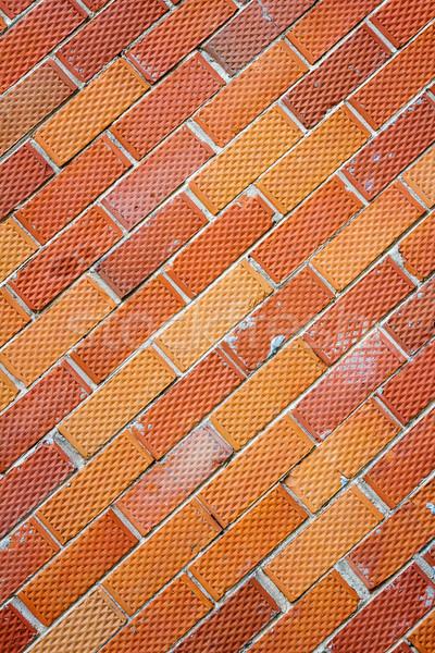 Edad pared de ladrillo rojo punteado textura resumen Foto stock © Taigi
