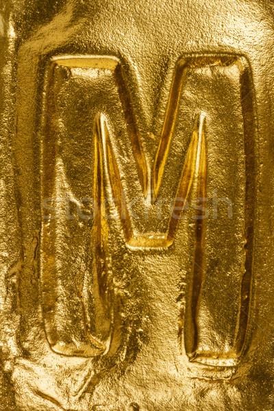 Altın mektup m güzel el yapımı parlak altın doku Stok fotoğraf © Taigi