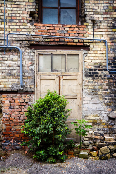 Old door of an abandoned house Stock photo © Taigi