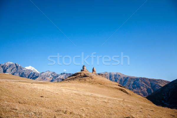 Templom Grúzia fű szépség hegy kék Stock fotó © Taigi