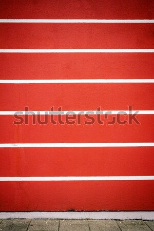 Stock photo: Red and white lined plaster wall