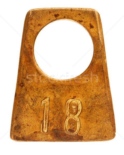 Ancient brass cloakroom label with number 18 Stock photo © Taigi