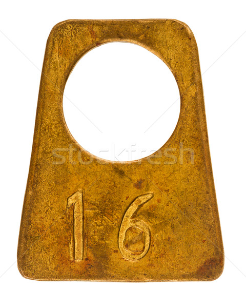 Stock photo: Ancient brass cloakroom label with number 16