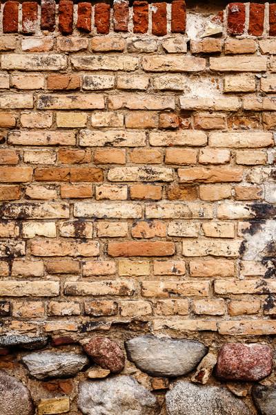 Amarillo pared de ladrillo piedra sótano edificio diseno Foto stock © Taigi