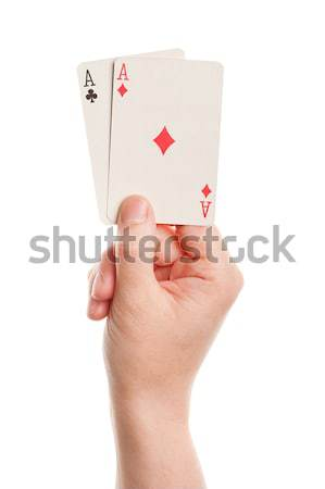 Playing cards in hand Stock photo © Taigi