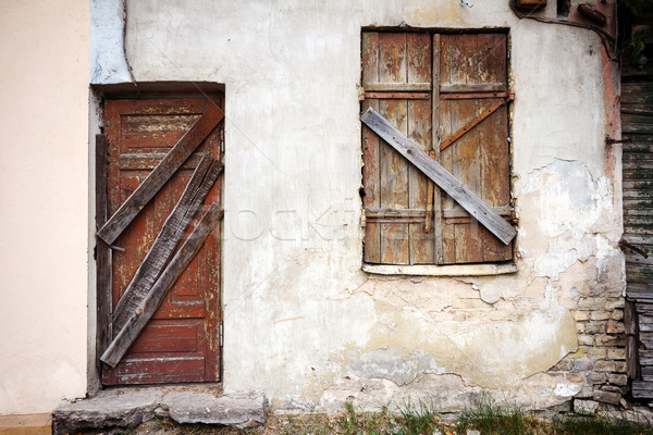 Boarded up window and old door Stock photo © Taigi