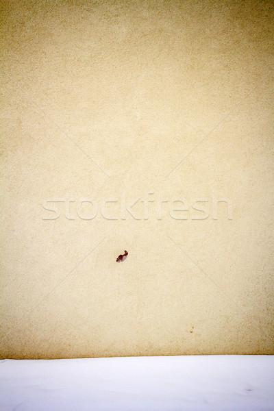 Jaune plâtre rue mur sol couvert Photo stock © Taigi