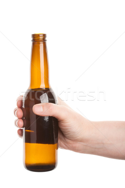 Bierfles hand geïsoleerd witte bier licht Stockfoto © Taigi