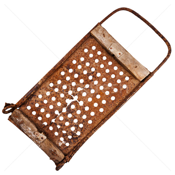 Stock photo: Old rusty cracked grater