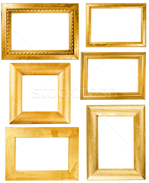Stock photo: Collection of wooden frames painted wirh gold