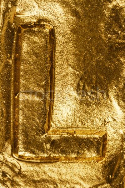 Lettera l bella lucido tessitura oro Foto d'archivio © Taigi