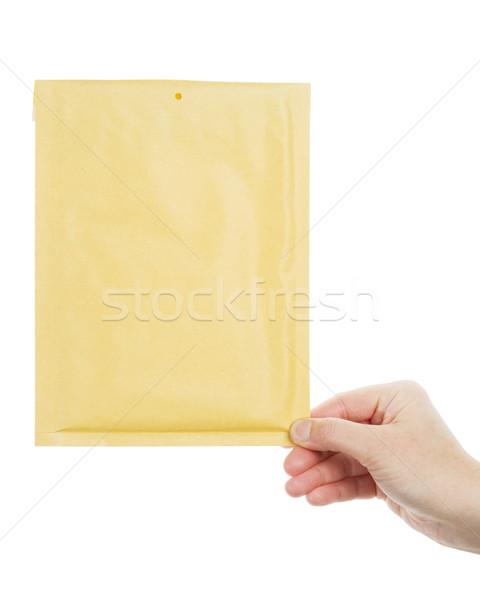 Yellow envelope in the hand  Stock photo © Taigi