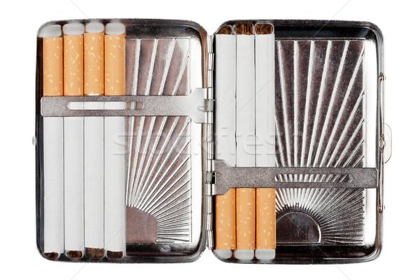 Stock photo: Cigarette case wit some cigarettes