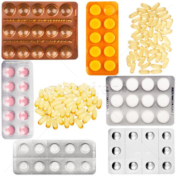 Szett tabletták műanyag hólyag csomag halolaj Stock fotó © Taigi