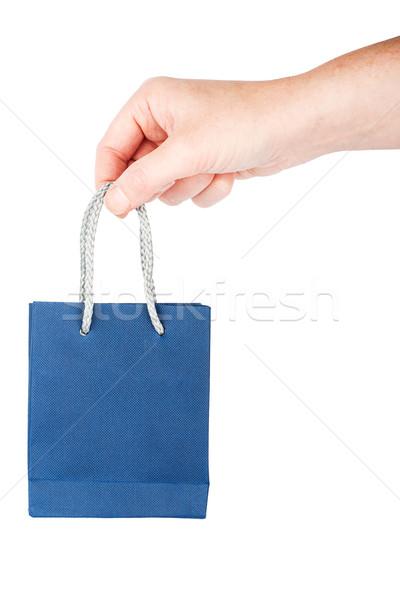 Hand holding little blue gift bag Stock photo © Taigi