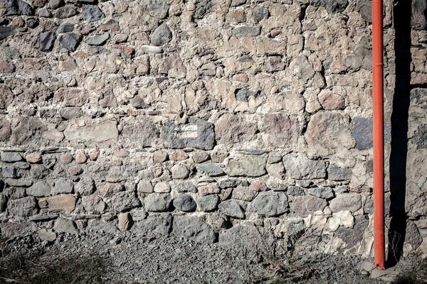 öreg kőfal cső viharvert fal kövek Stock fotó © Taigi