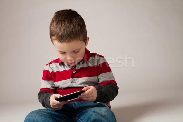Menino jogar jogo vídeo bonitinho pequeno Foto stock © Talanis