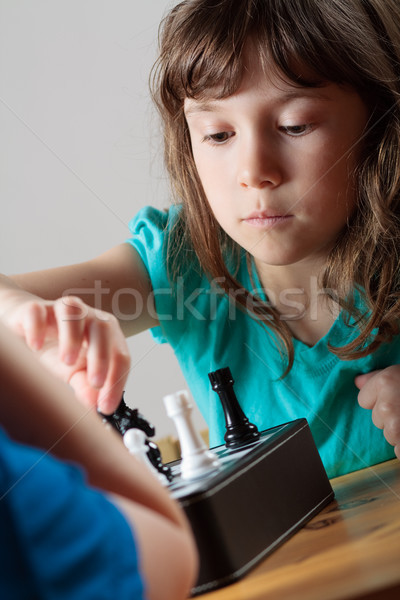 Girl playing chess Stock photo © Talanis
